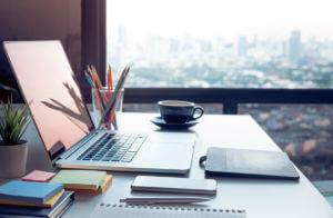 modern office, laptop, window overlooking city