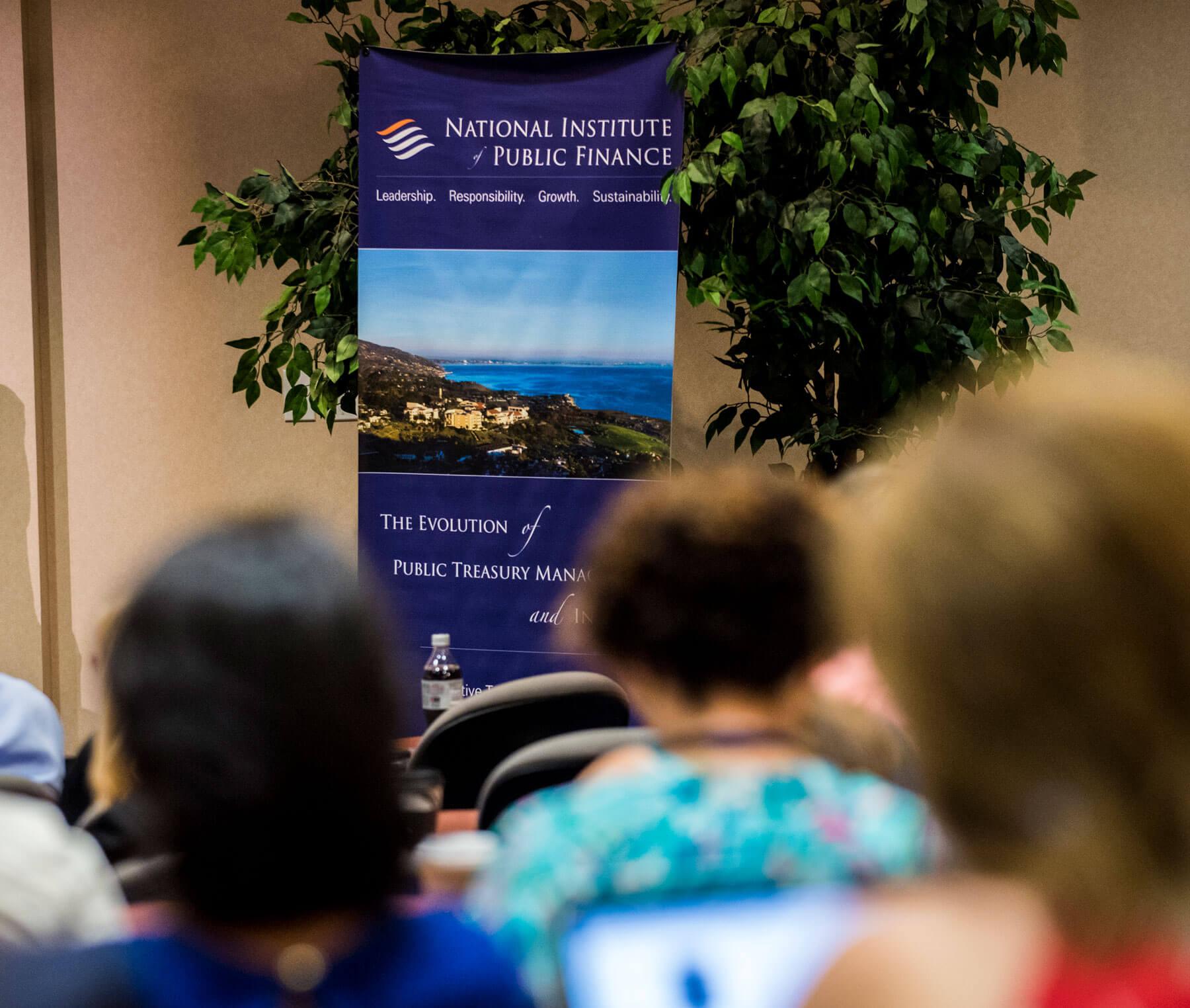 NIPF attendees, banner